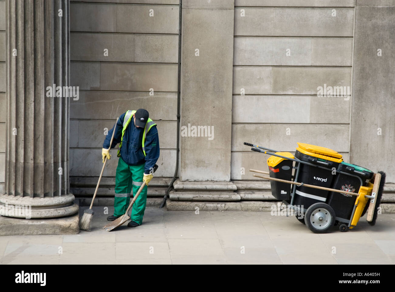 Street sweeper working in the City of London, England, UK Stock Photo
