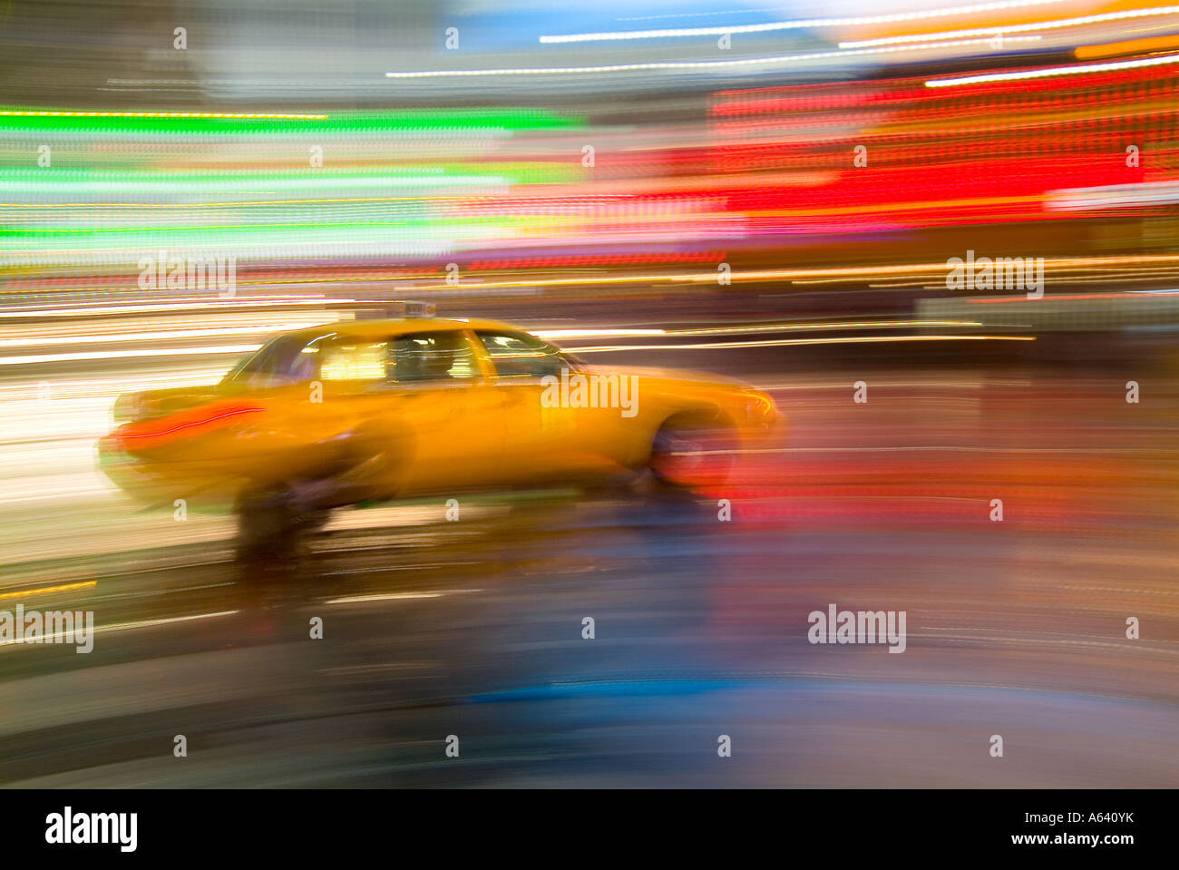 Taxi Cab, New York City At Night With Motion Blur And Bright Lights, Times Square, New York City, USA - Stock Image