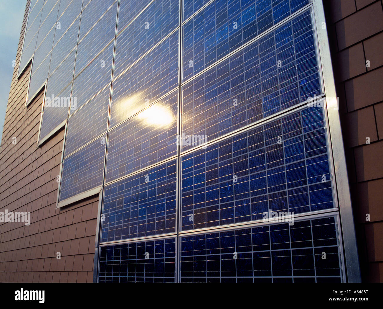 solar power solar panels at facade of apartment building - Stock Image