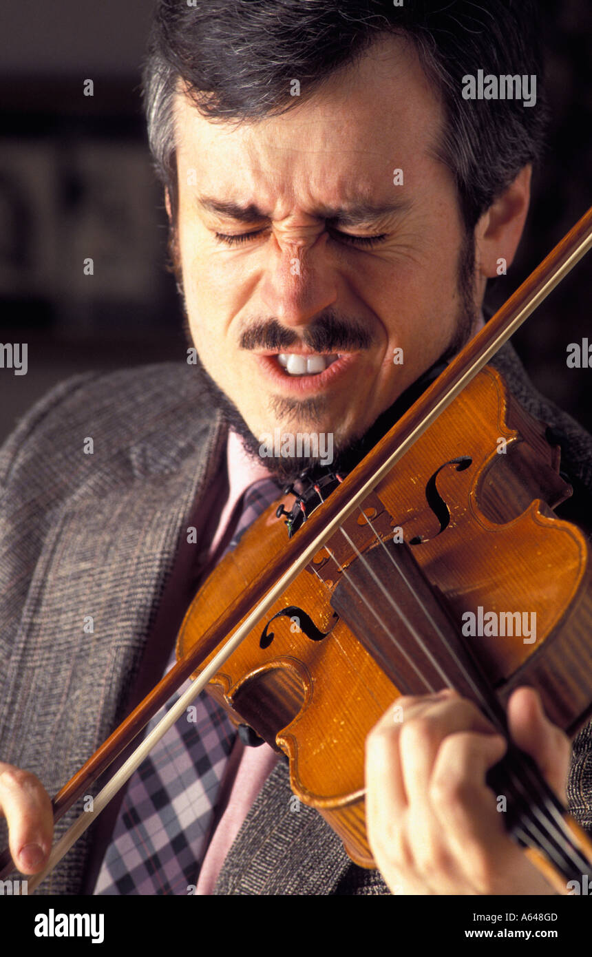 untalented viola player hitting a sour note Stock Photo