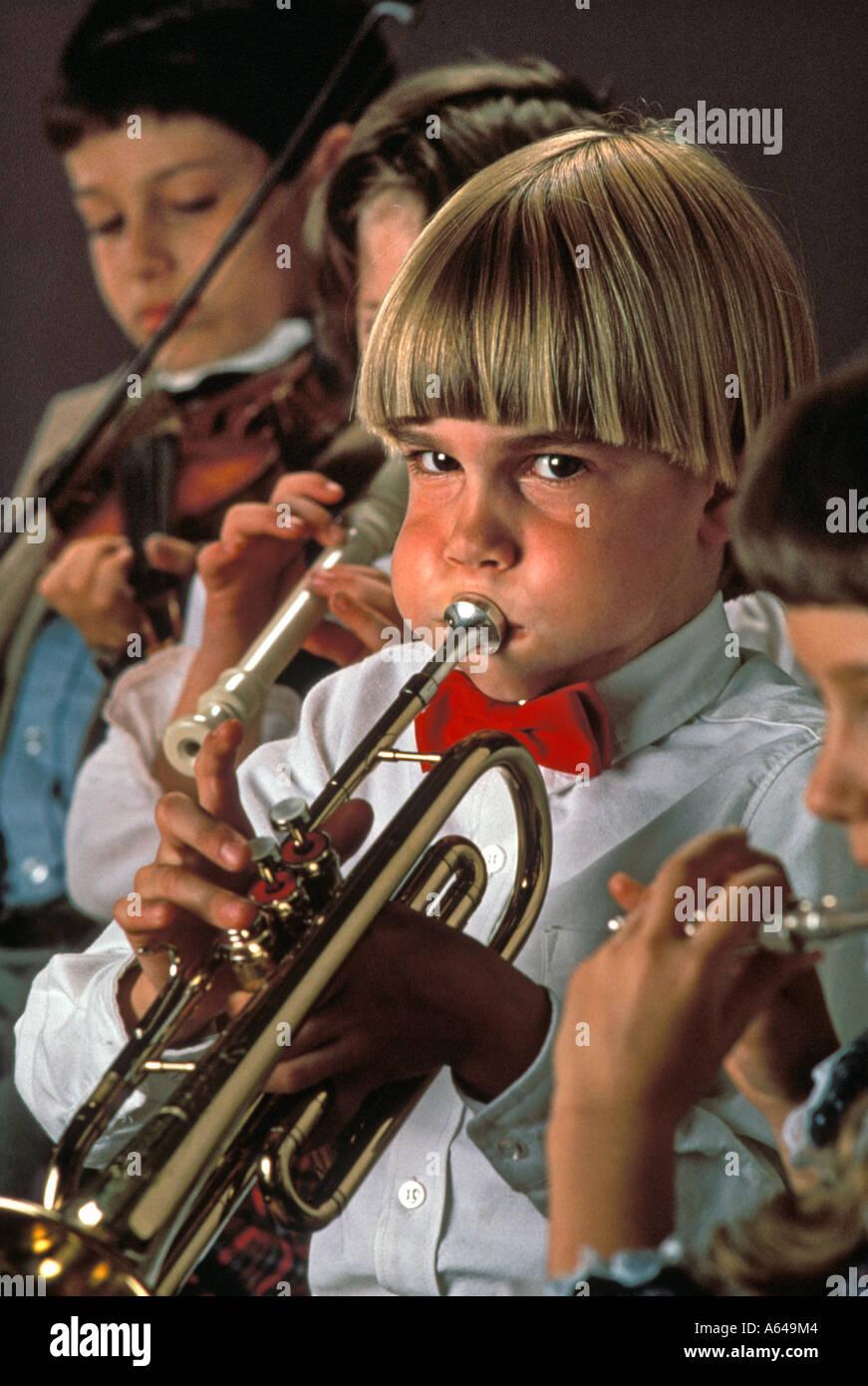 children performing at music recital - Stock Image