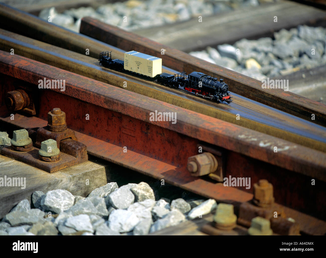 scale model of cargo train crossing railroad track editorial use only - Stock Image