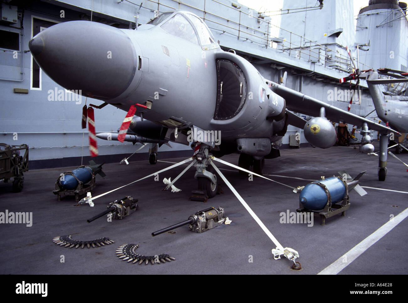 HMS Illustrious flight deck with Sea Harrier and armaments display - Stock Image