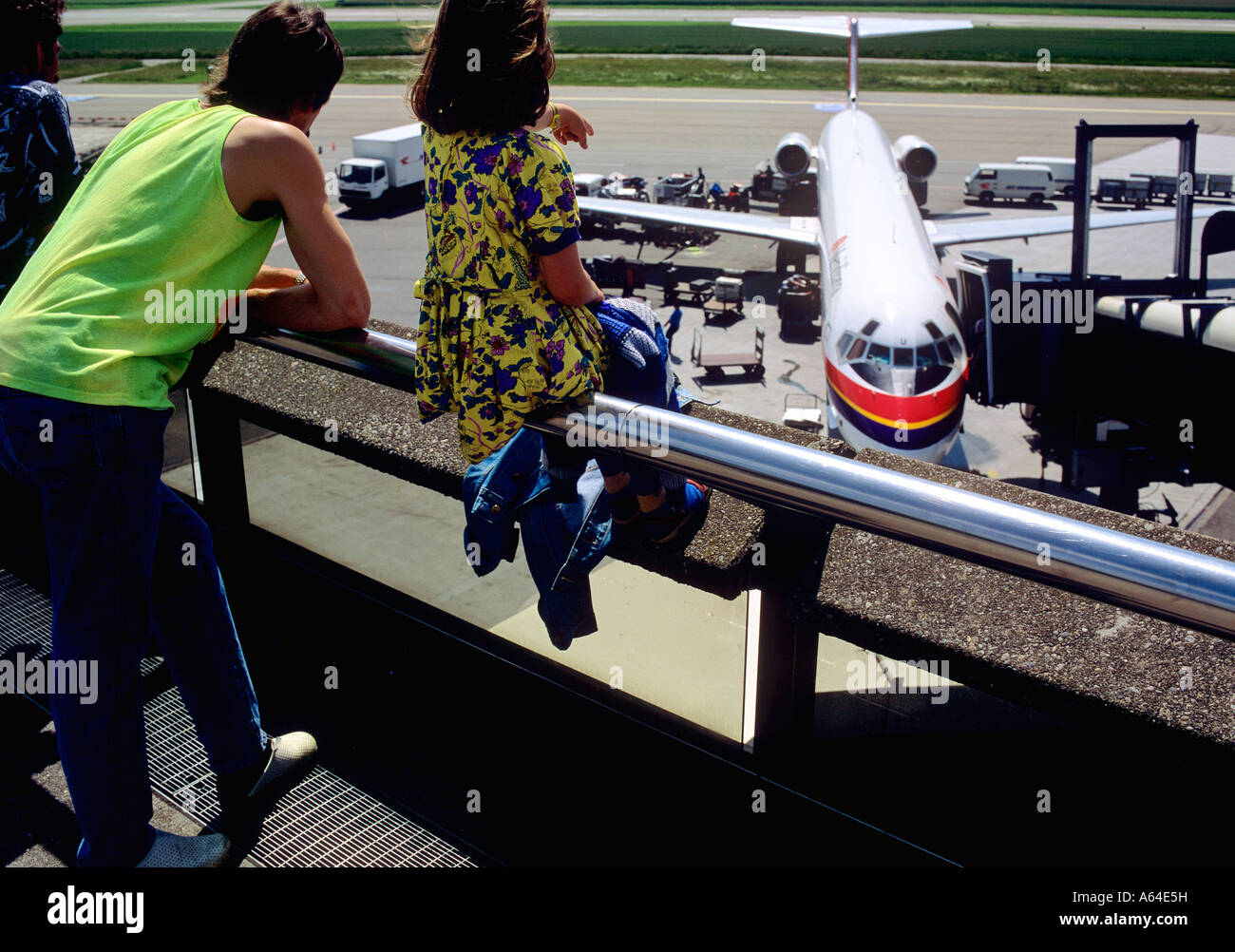 spotting charter airplane on spectators gallery at zurich airport switzerland - Stock Image
