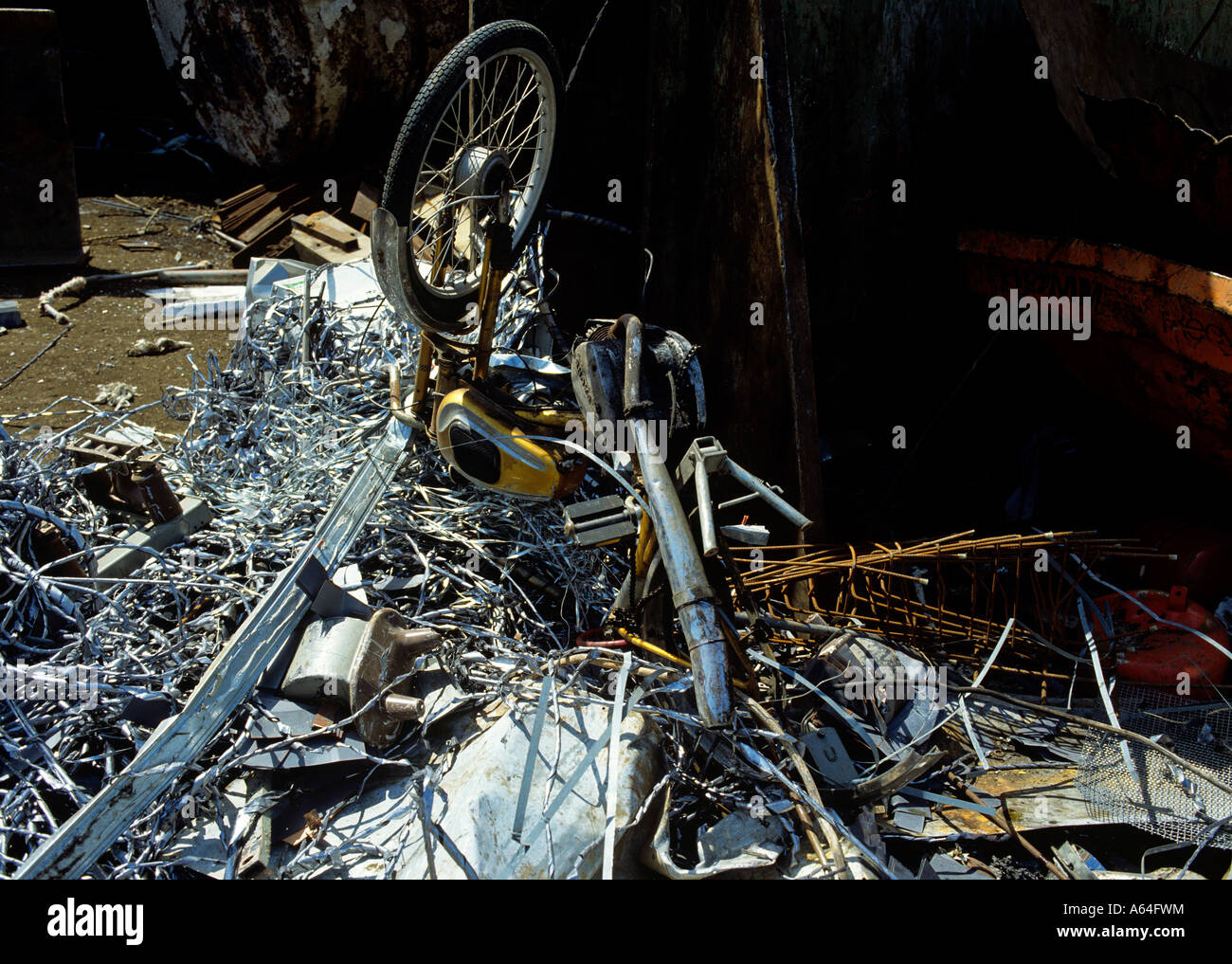 moped wreck and scrap at recycling scrap yard - Stock Image