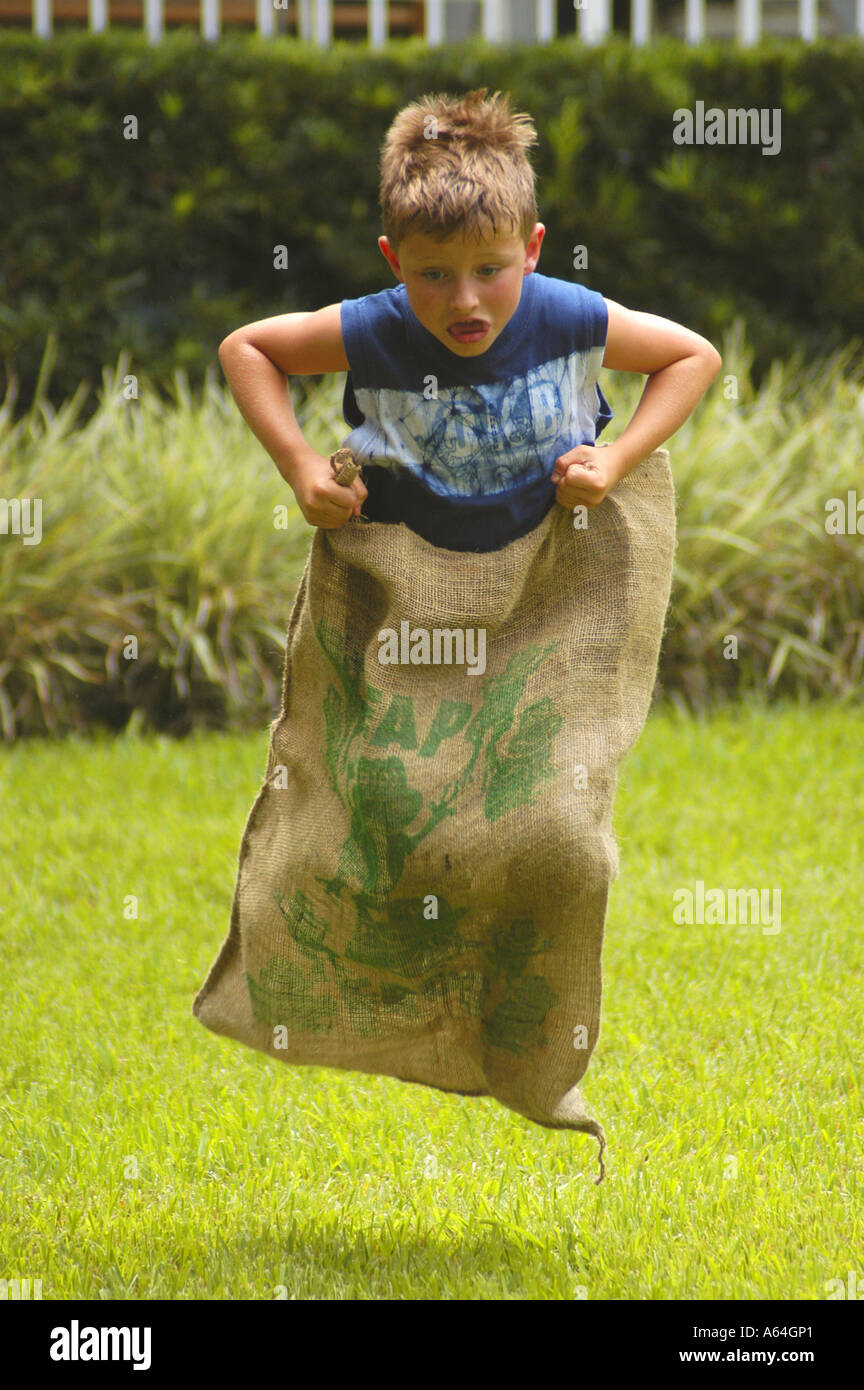 Boy determined look sack race Stock Photo