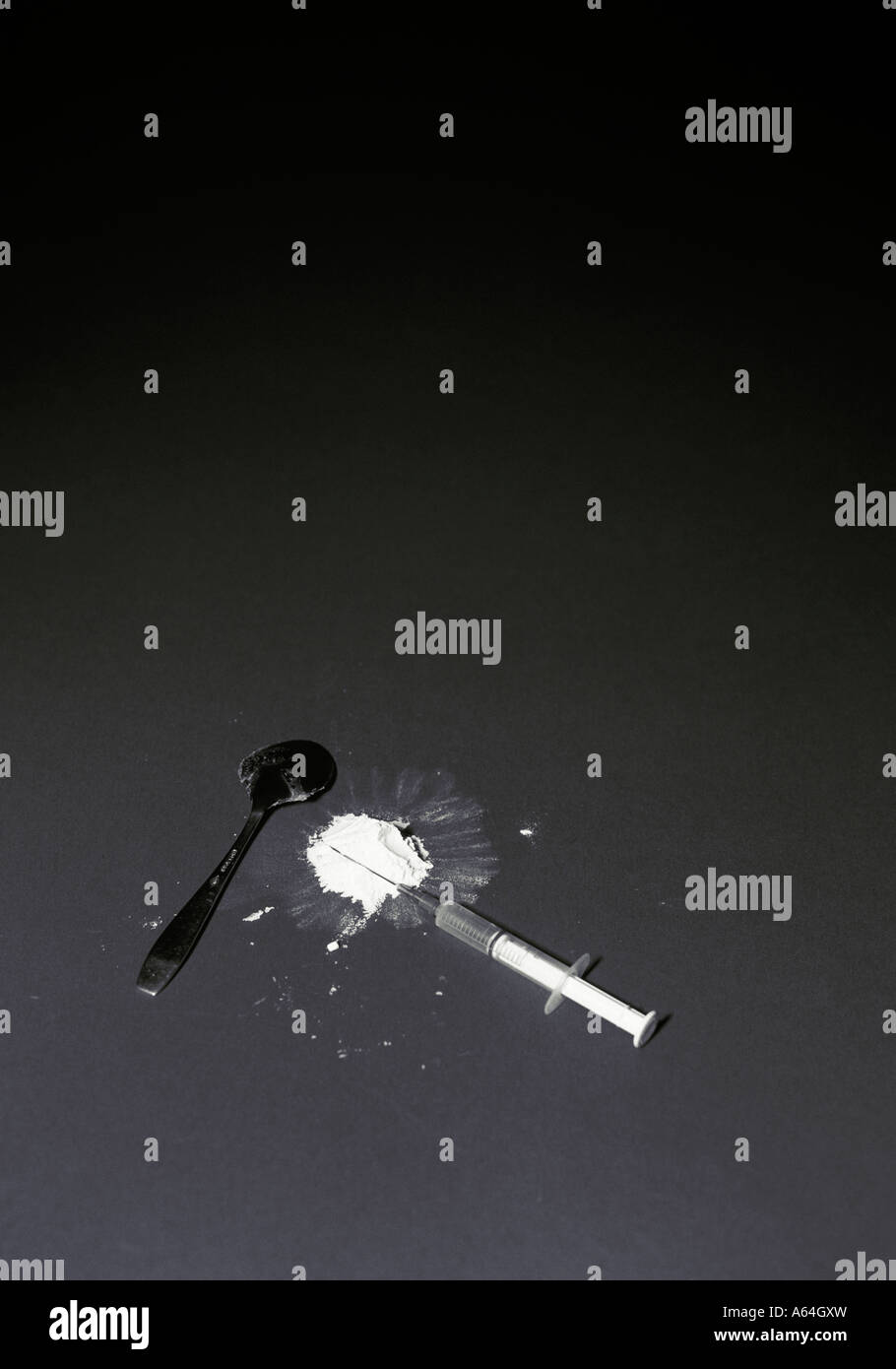 syringe and spoon and heroin - Stock Image
