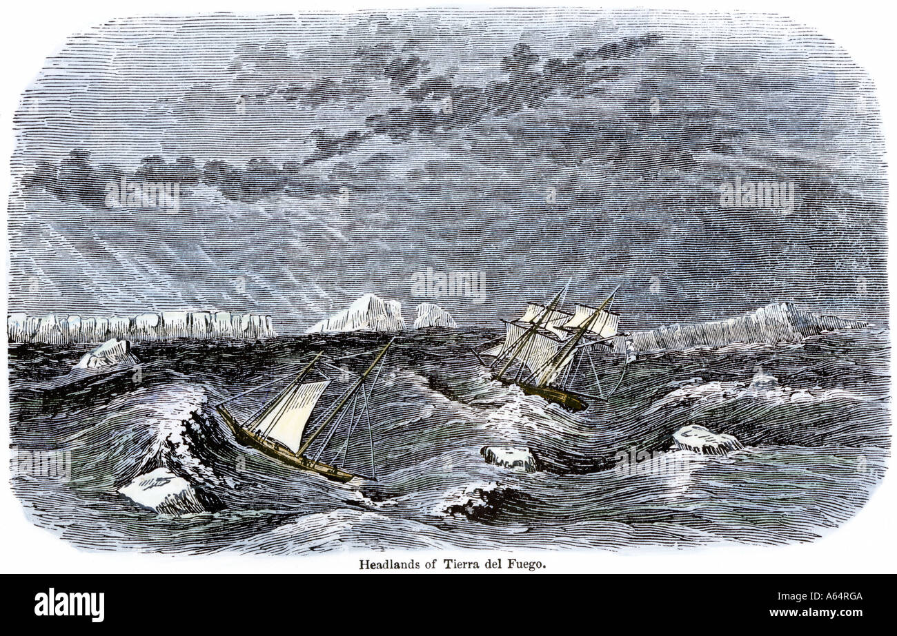 Sailing-ships in the Strait of Magellan rounding Cape Horn in sight of Tierra del Fuego. Hand-colored woodcut - Stock Image
