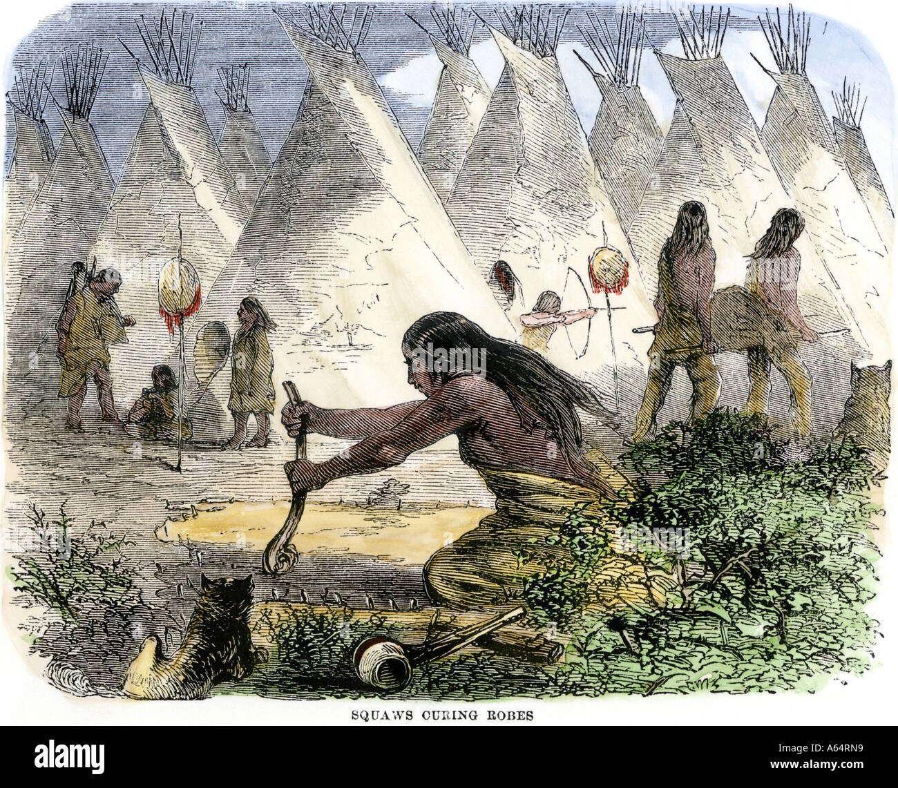 Native American women curing buffalo hides in a village of tipis. Hand-colored woodcut - Stock Image