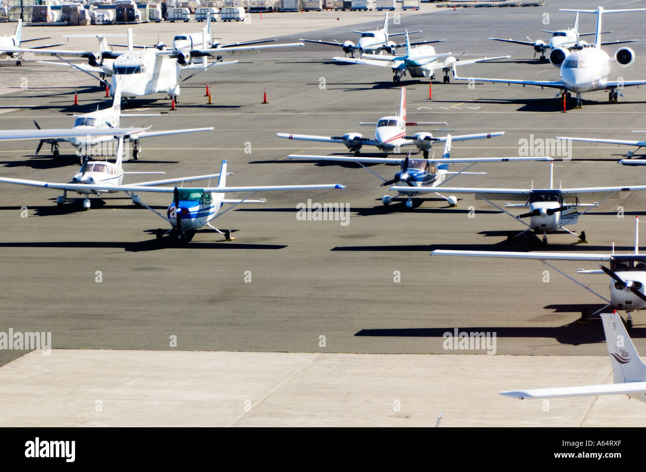 Small planes on the tarmac at the airport in Honolulu Oahu Hawaii. - Stock Image
