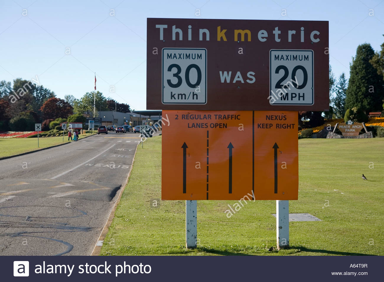 Road sign showing difference in speed limits between metric and imperial measurements - Stock Image