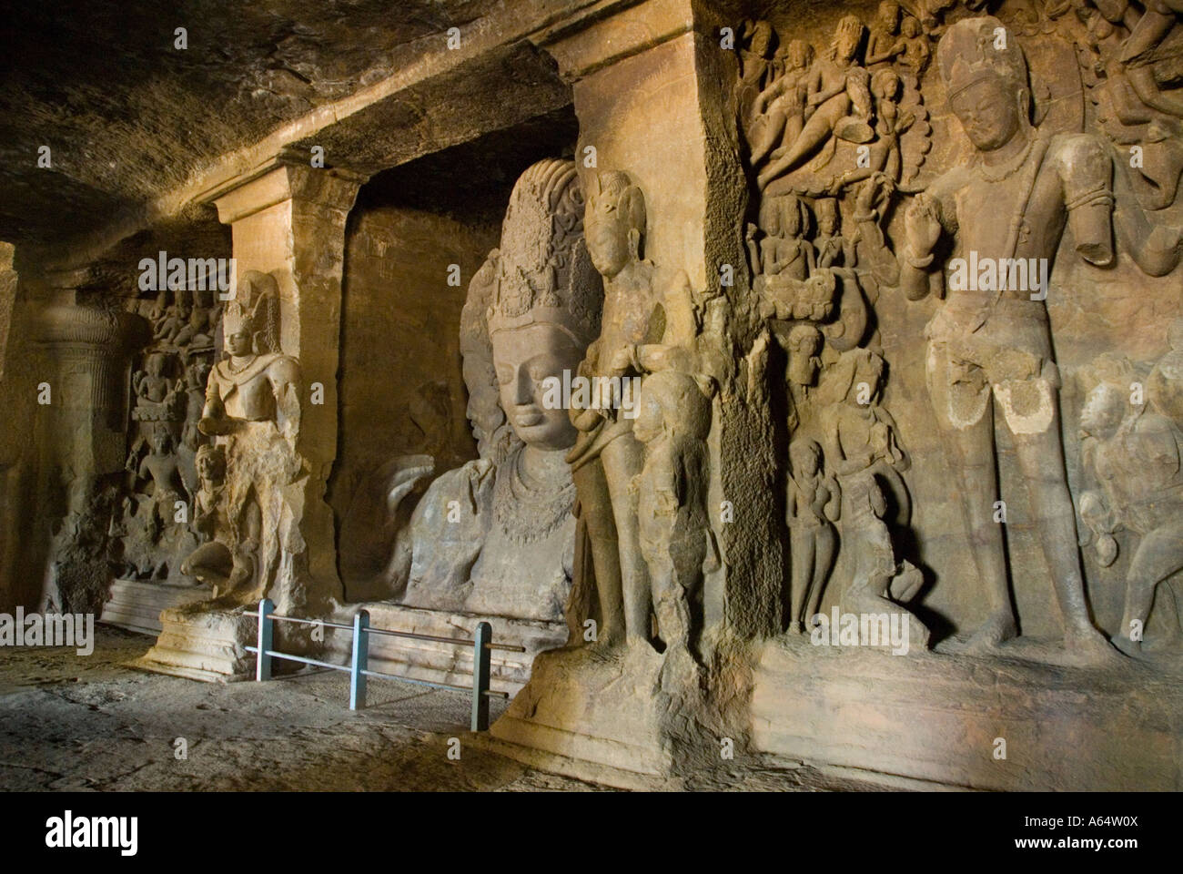 Shiva statues inside the cave temples on Elephanta Island India - Stock Image