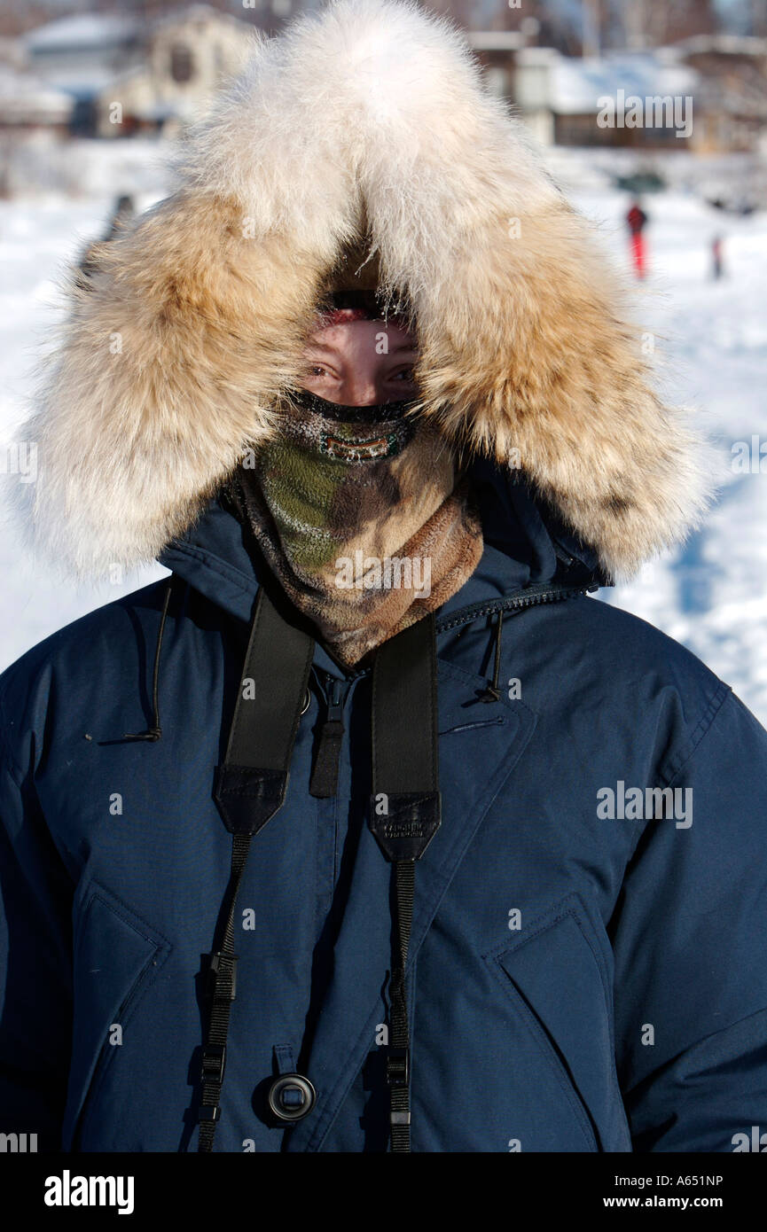 A Woman Bundled Up Against The Cold With A Fur Ruff In