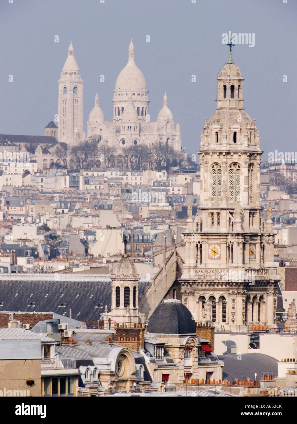 View of the Saint Trinity Church in the foreground and then the Sacré Coeur from the terrace of le Printemps, - Stock Image