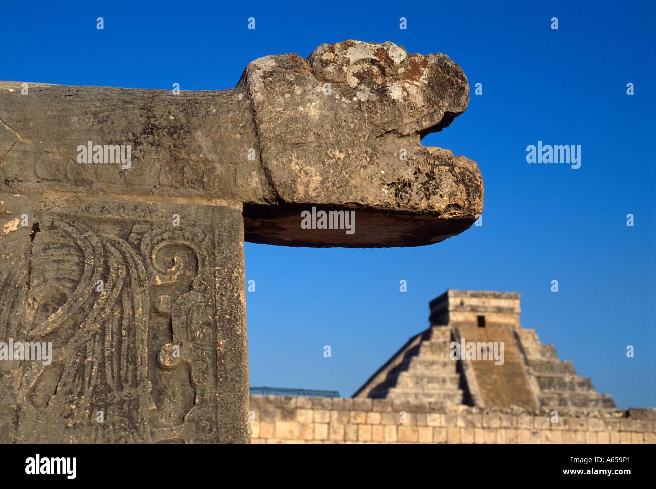 Serpent head sculpture and El Castillo pyramid Mayan ruins, Chichen Itza, Yucatan, Mexico - Stock Image