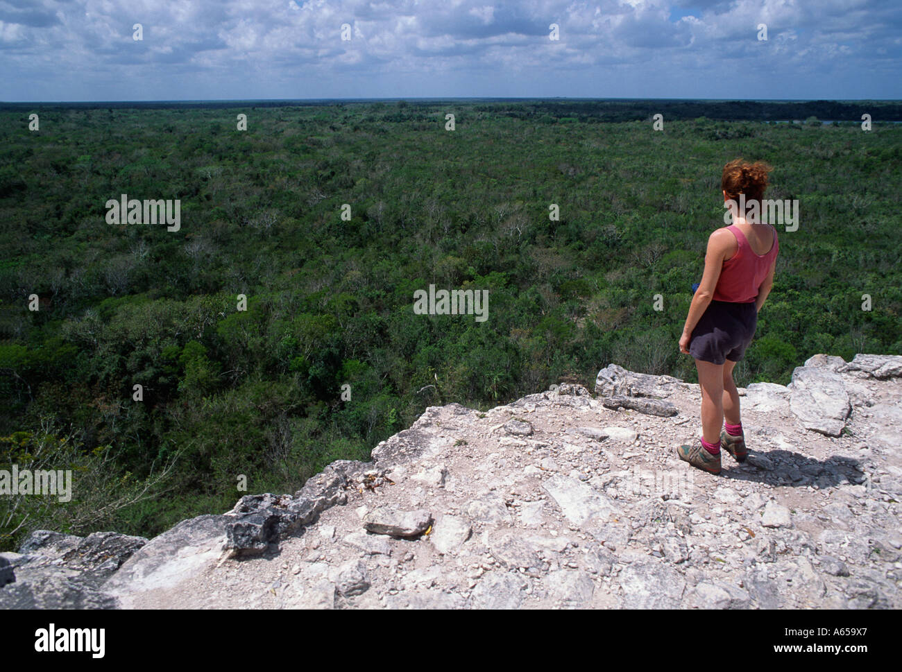 Traveller tourist female woman on top of Nohoc Mul, tallest Mayan pyramid in the Yucatan, Coba, Mexico - Stock Image