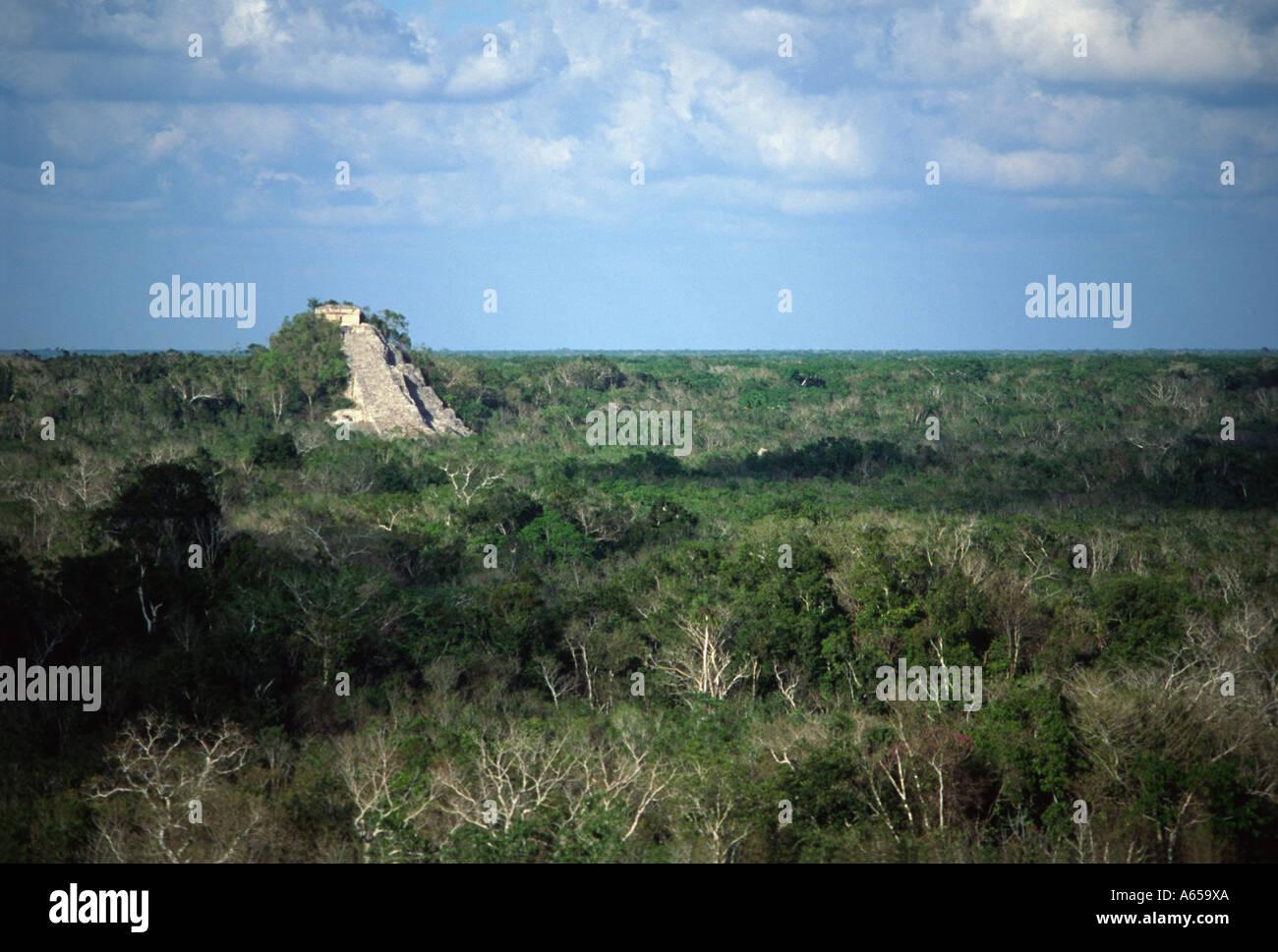 Mayan pyramid ruin surrounded by forest, ancient city of Coba, Yucatan Peninsula, Mexico - Stock Image