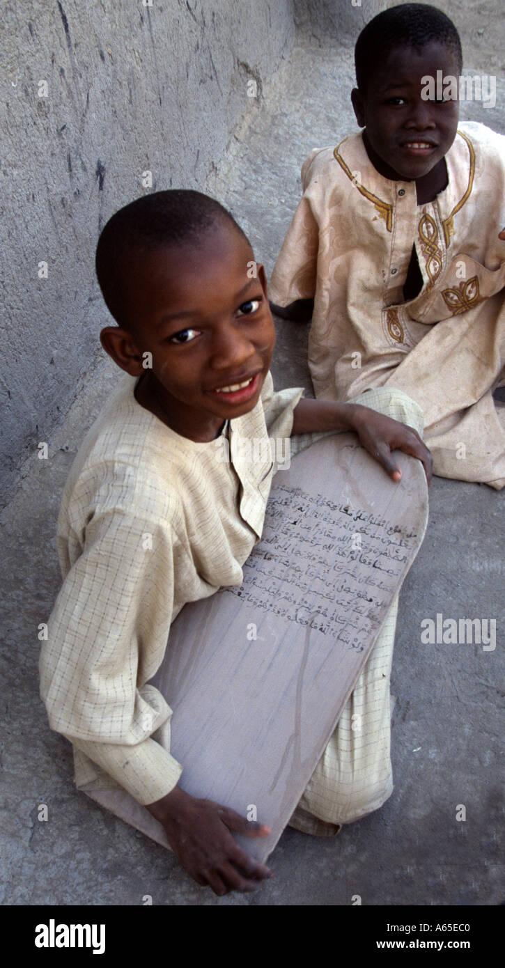 Boy learning the Koran Djenne Mali West Africa - Stock Image
