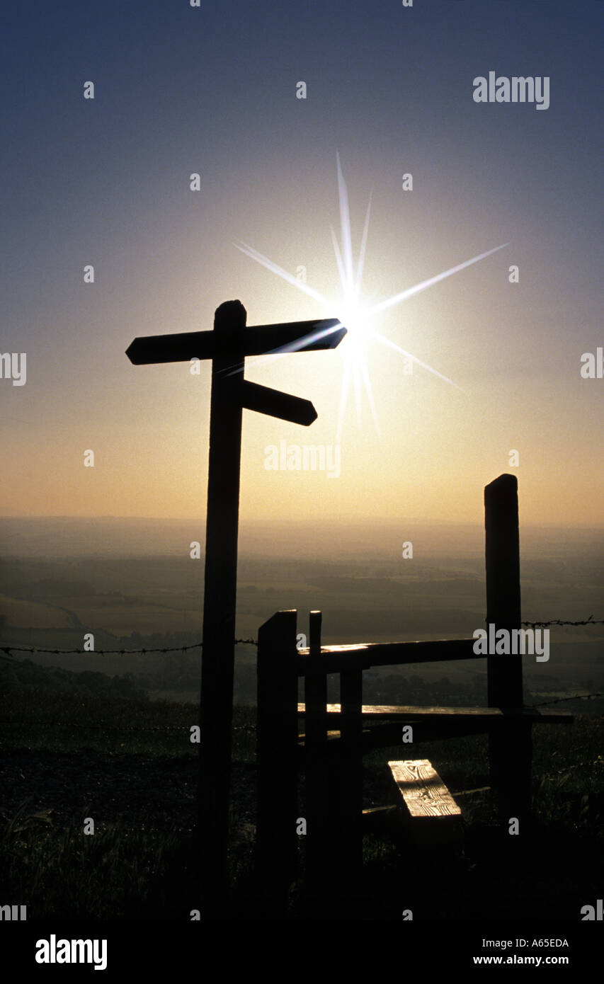 Signpost and stile South Downs Sussex England - Stock Image