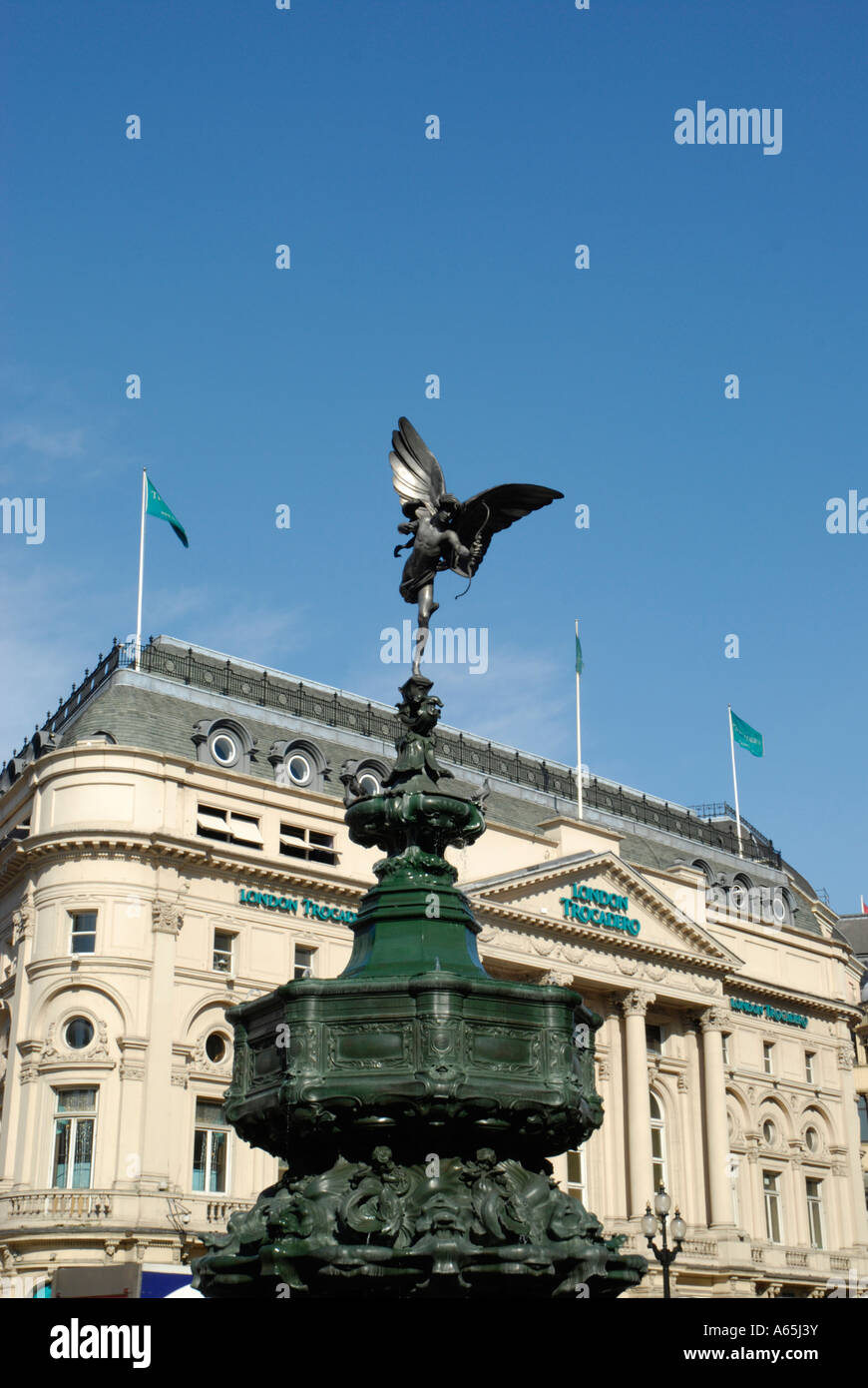 Statue of Eros against the London Trocadero Piccadilly Circus London England - Stock Image