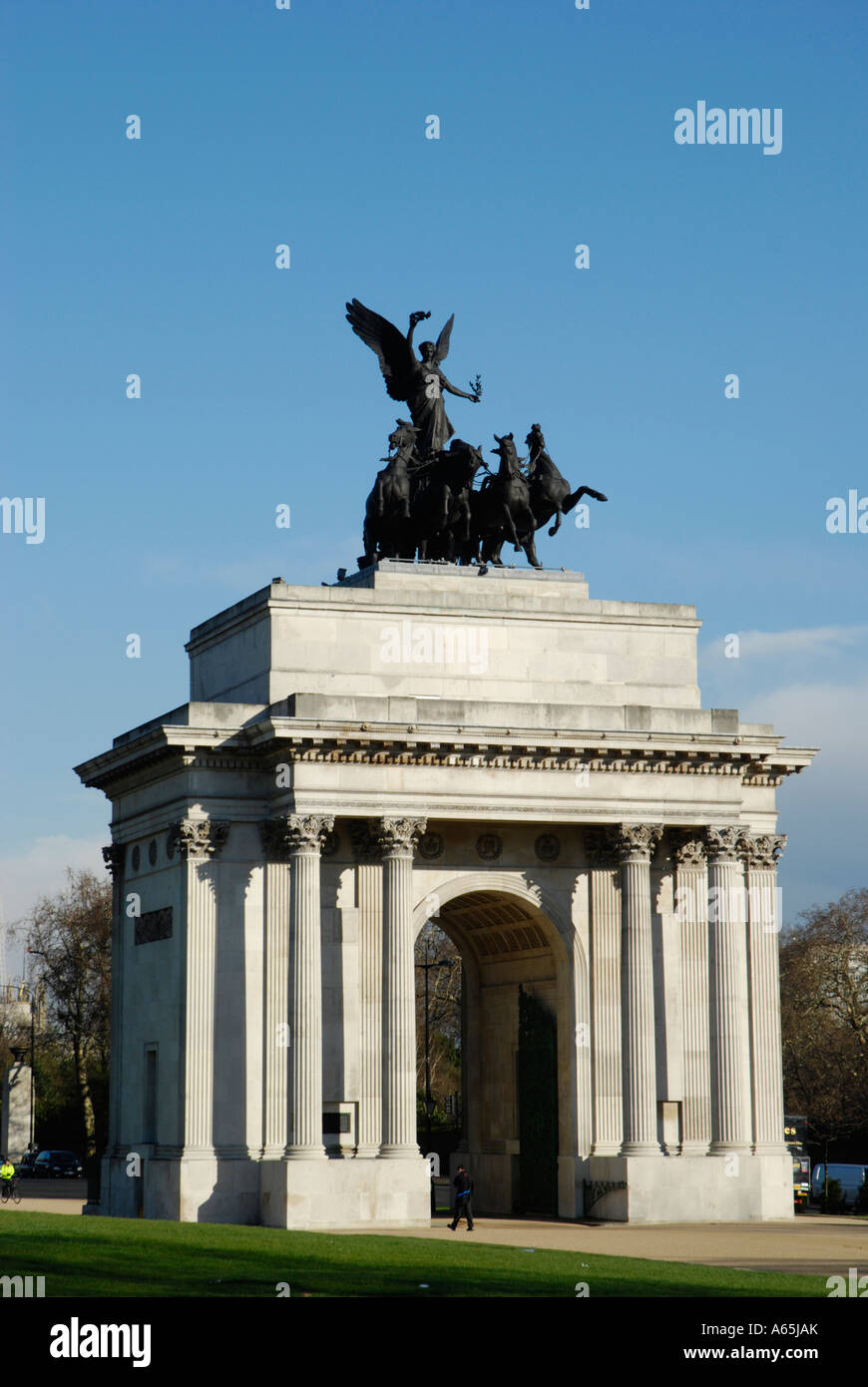 Front view of Wellington Arch against blue sky at Hyde Park Corner London England - Stock Image