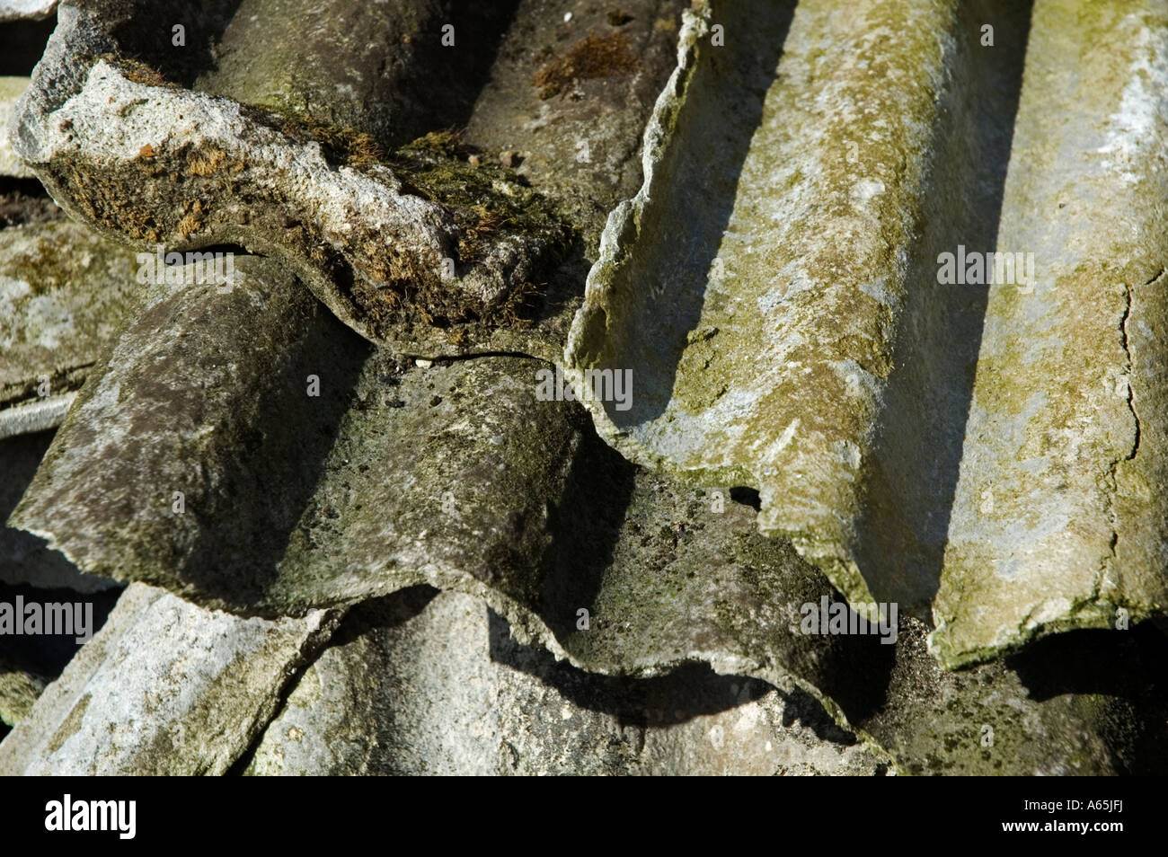 old broken asbestos roofing sheets - Stock Image