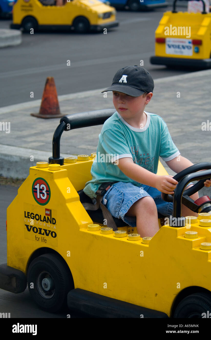 Young boy driving a lego car at Funland LegoLand tourist amusement attraction in Carlsbad San Diego County California Stock Photo