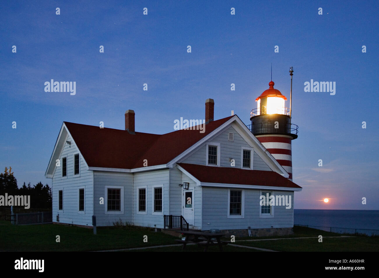 Moonrise and West Quoddy Head Lighthouse Near Lubec Maine - Stock Image