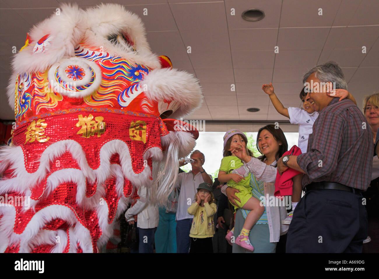 Malaysian Lion dance entertains children and parents - Stock Image