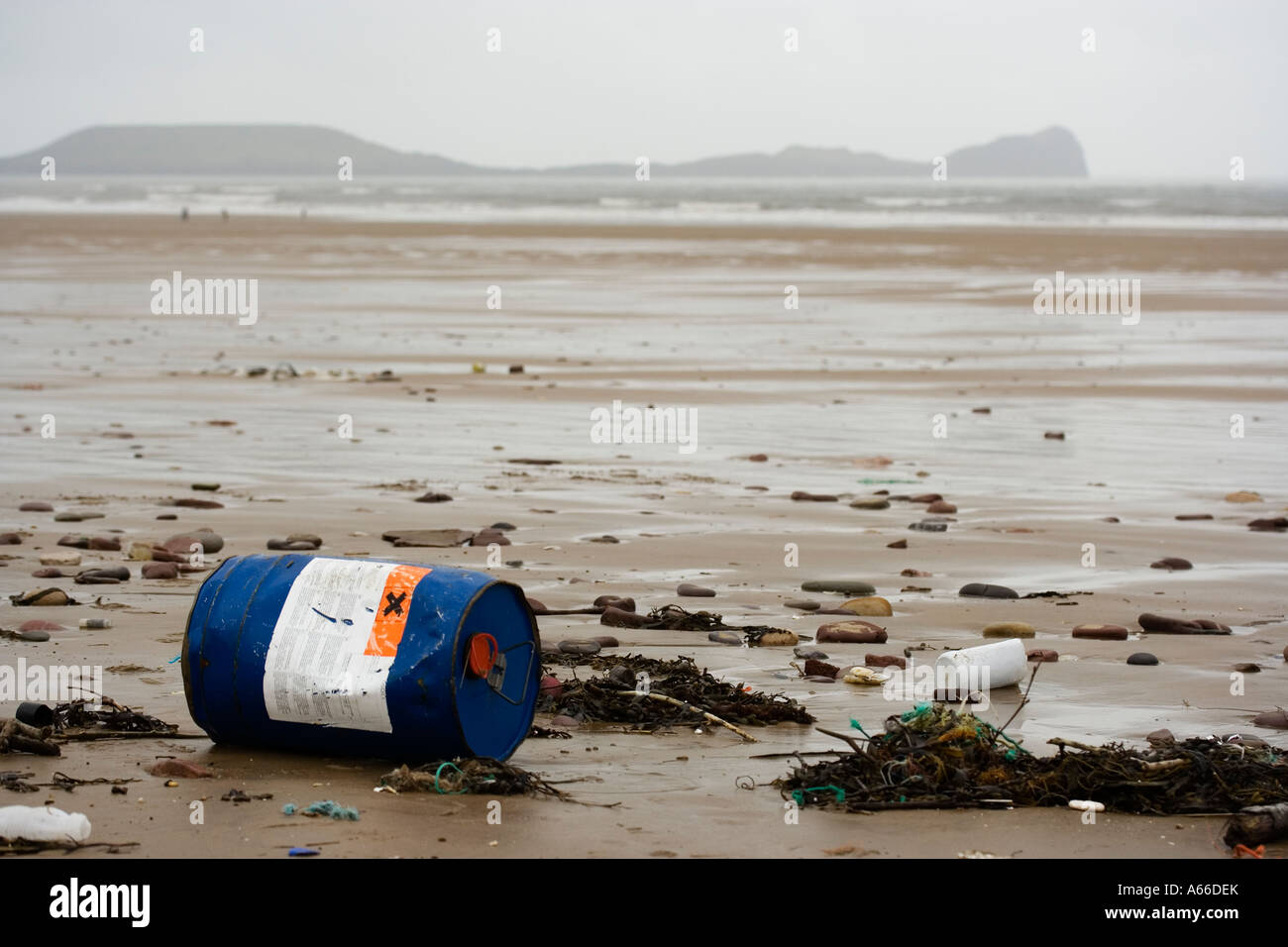Toxic container washed onto beach - Stock Image
