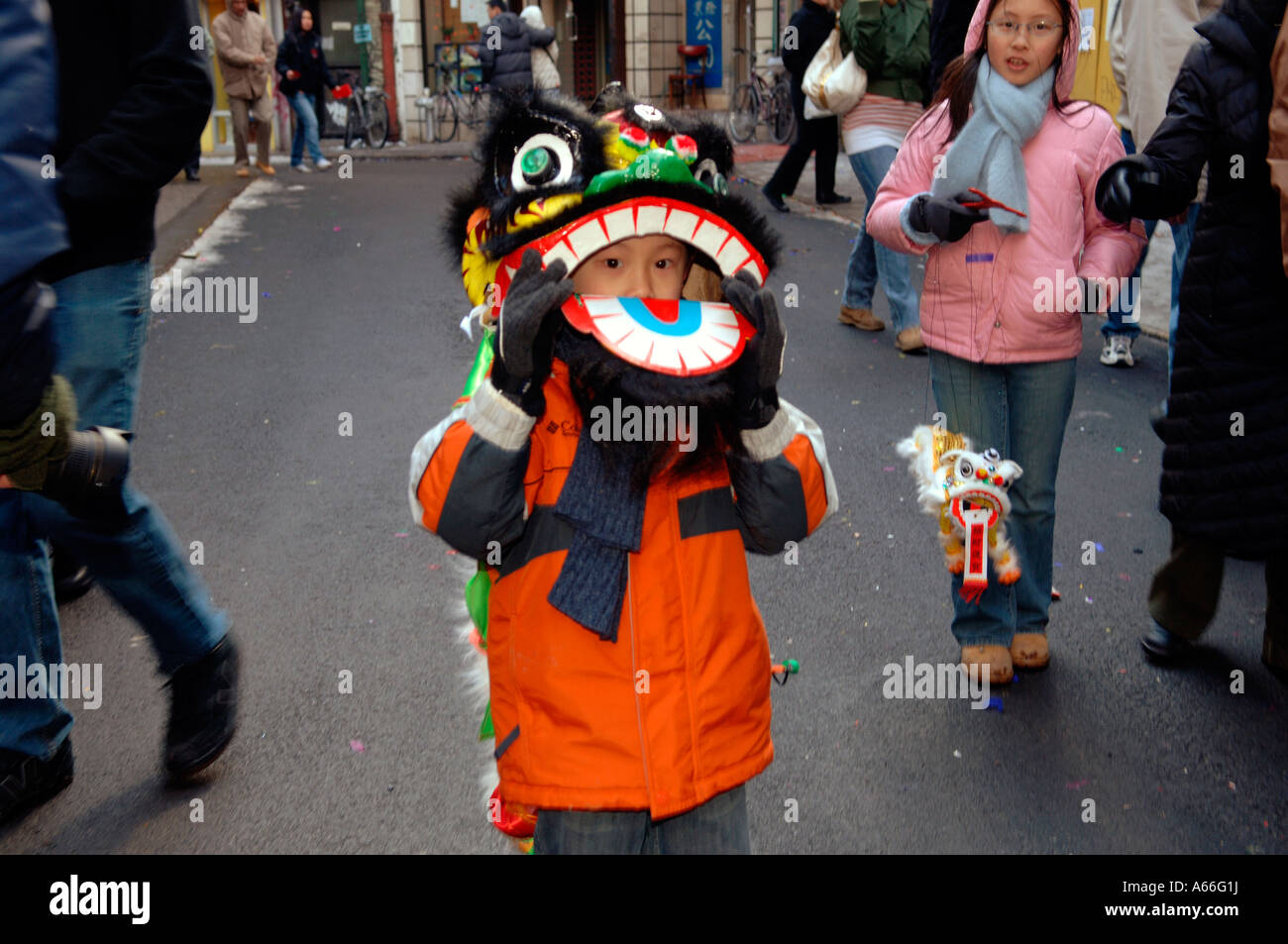 ca8dc924e Child wears lion dancing costume in Chinatown in NYC during the ...