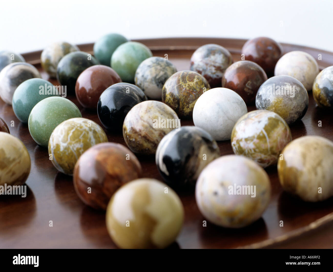 close up of a solitaire game with marble balls - Stock Image
