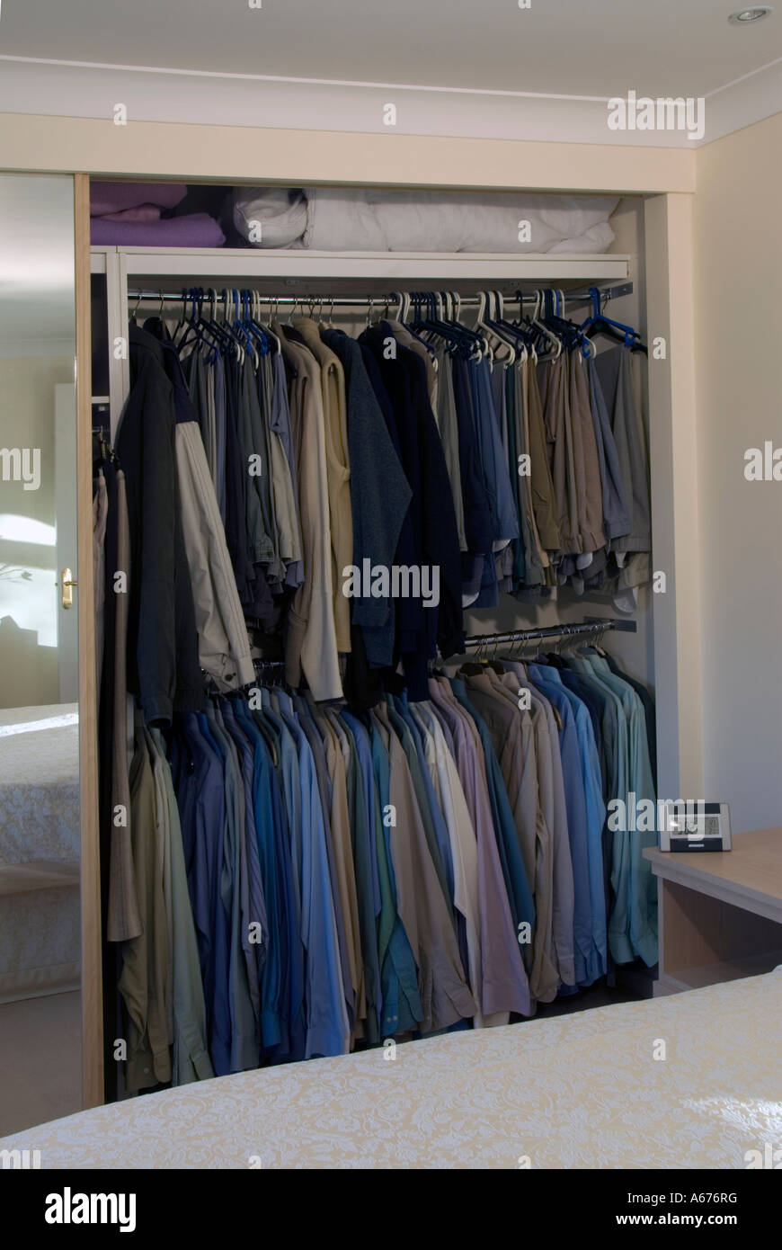 Male Section Shared Built In Open Tidy Bedroom Wardrobe Full Of Mens Stock Photo Alamy
