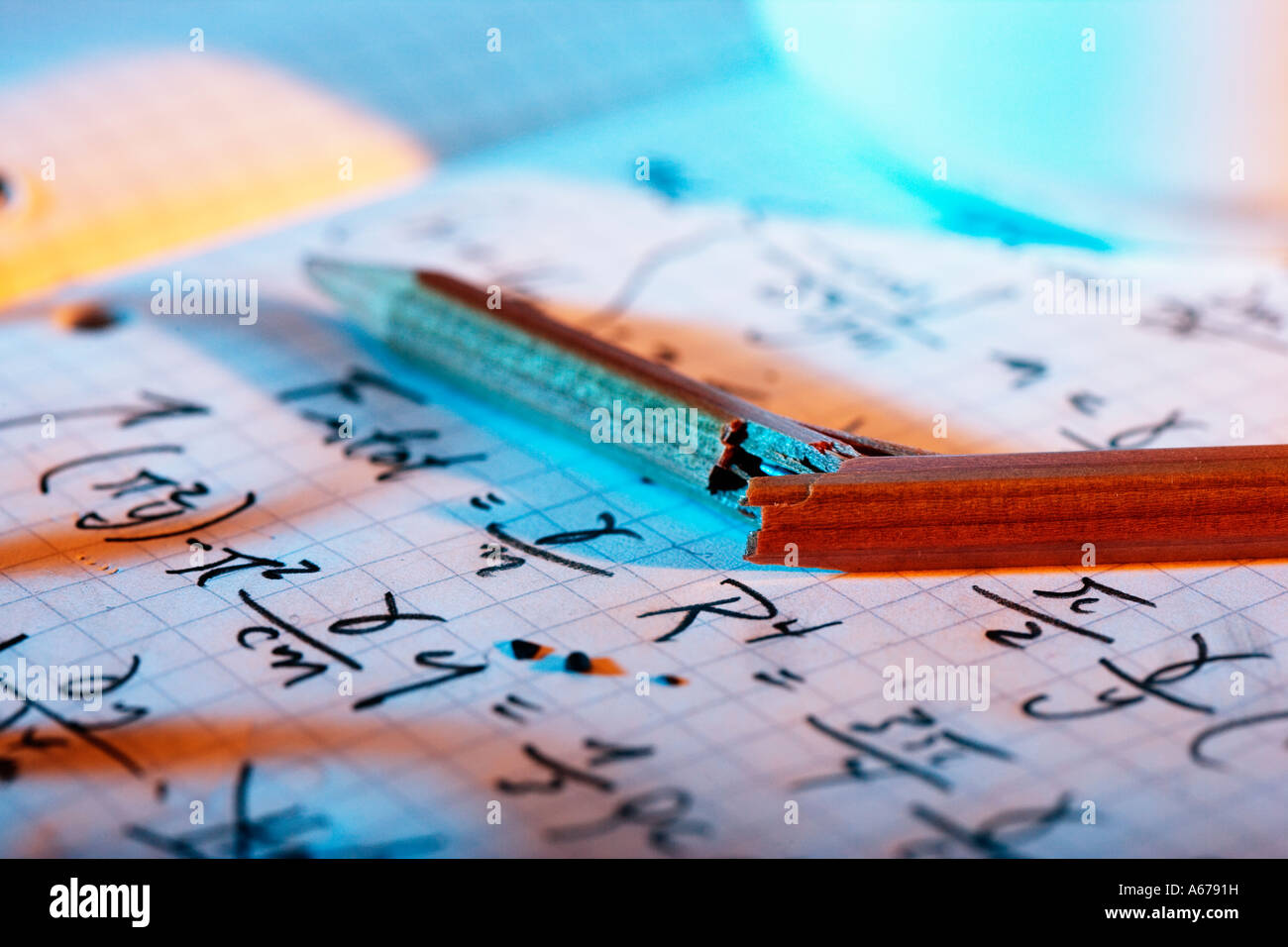 Page of mathematical equations with shadow of eye-glasses and broken pencil. - Stock Image