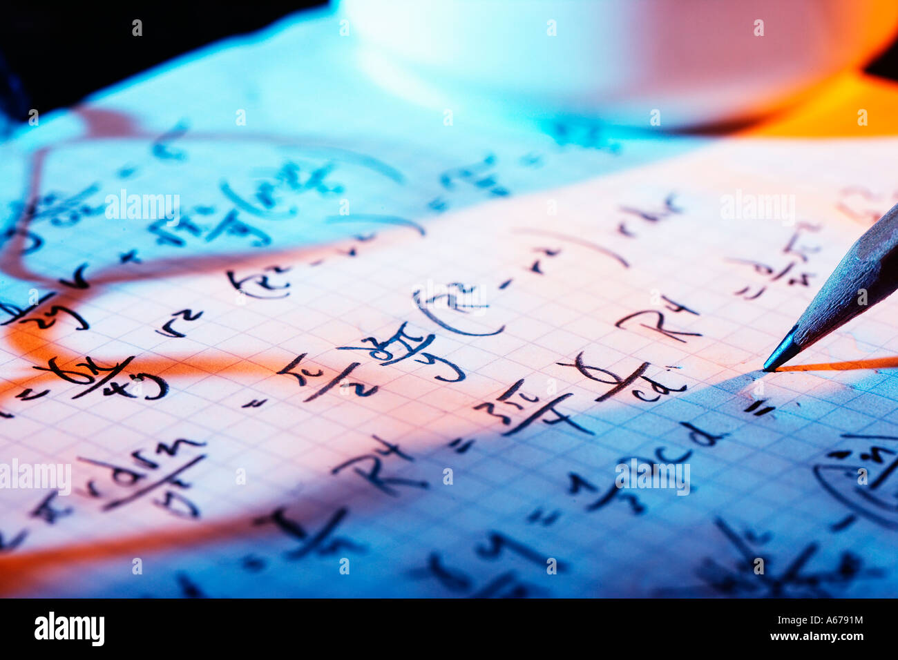 Page of mathematical equations with shadow of eye-glasses - Stock Image