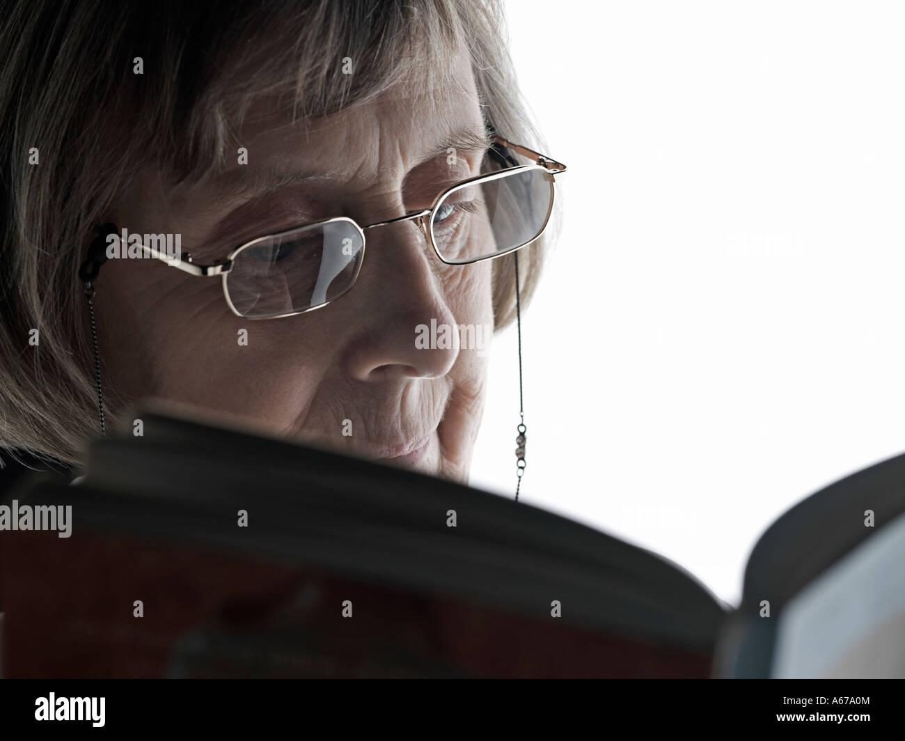 older woman reading - Stock Image