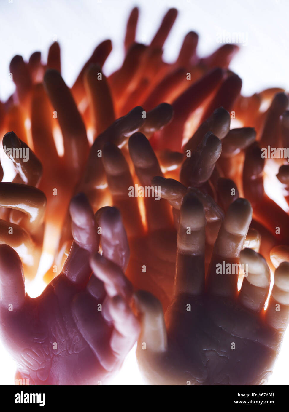 hands reaching together - Stock Image