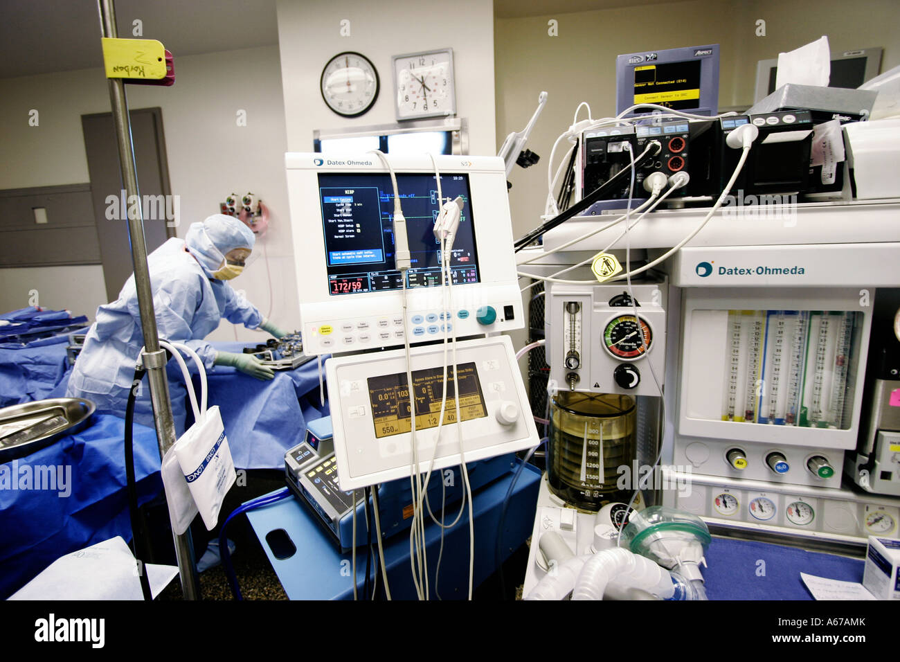 machines for monitoring vital signs and regulating dosages used by anesthesiologist in operating room - Stock Image