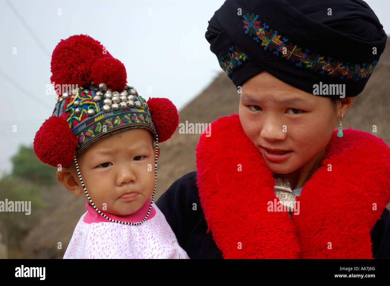 Portrait Of Young Yao Mien Indigenous Mother In Her Traditional Stock Photo Alamy