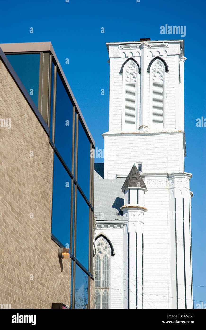 Religion and money contrasted with a church and a bank in Fredericton, New Brunswick, Canada - Stock Image