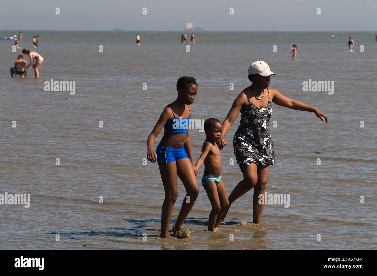 Children with mother on the mud flats Southend on Sea, Essex  England 2006. Photograph by Homer Sykes - Stock Image