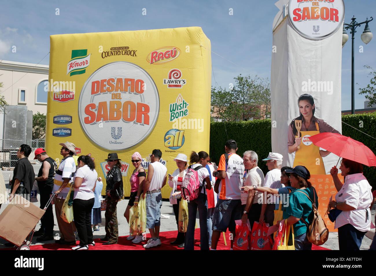 Miami Florida Little Havana Calle Ocho annual Hispanic festival Unilever product promotion free samples line - Stock Image
