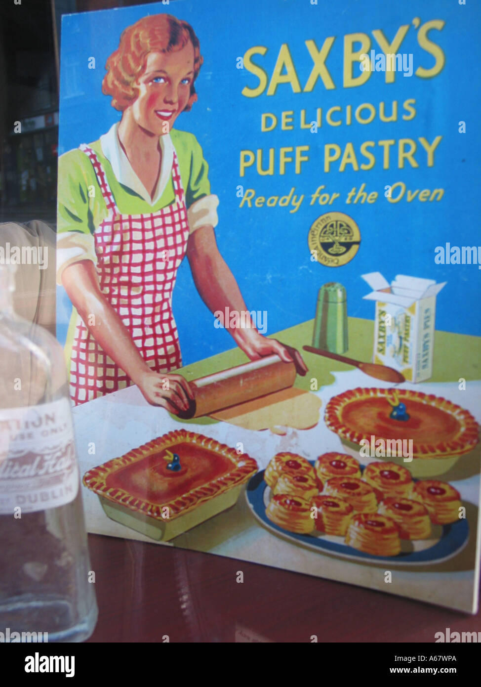 vintage style advertisement in shop window display for Saxby's home baking products Dublin Ireland - Stock Image