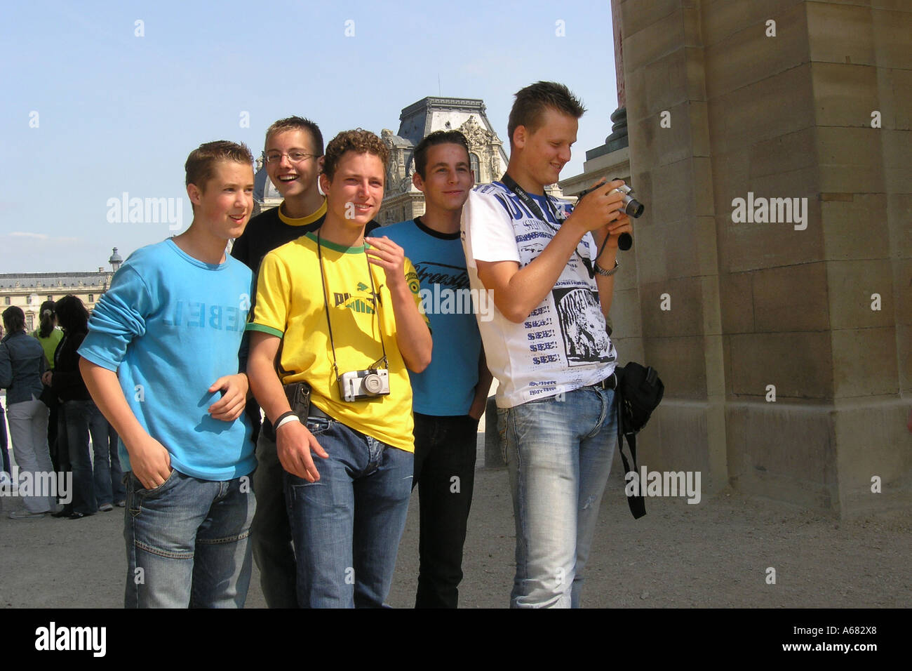 group of adolescent schoolboys posing near Louvre in Tuileries Gardens paris France - Stock Image