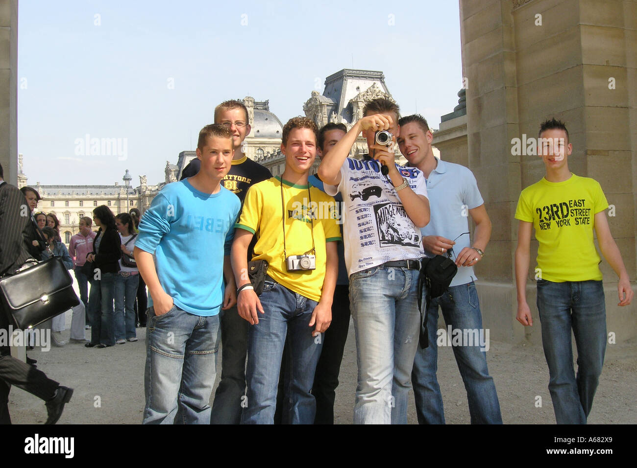 group of seven adolescent schoolboys posing near Louvre in Tuileries Gardens paris France - Stock Image