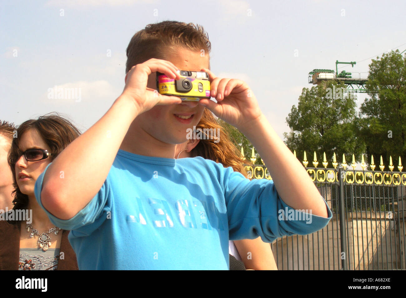 adolescent boy taking snapshot with SUC in Paris France Stock Photo