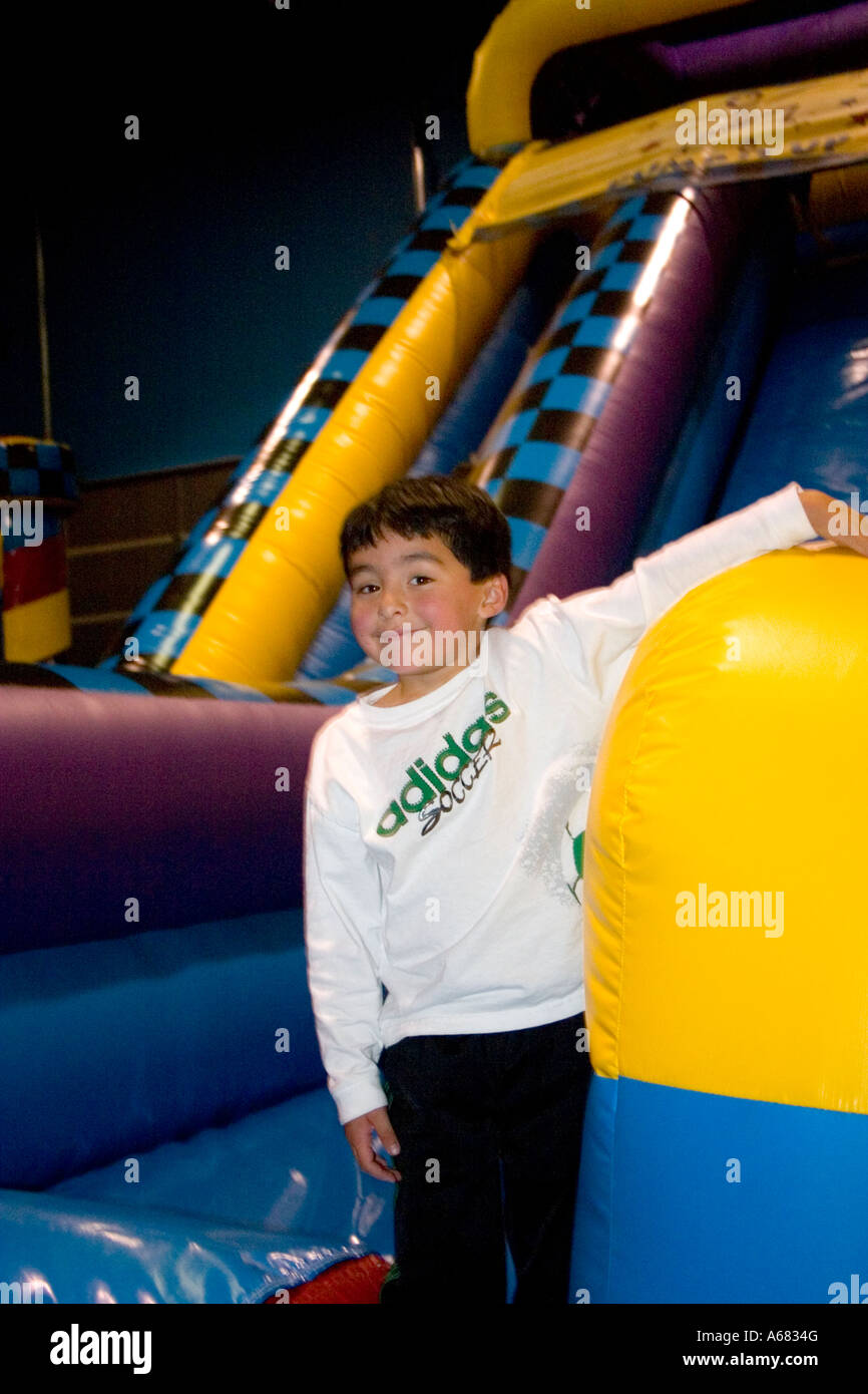Boy age 7 resting at Pump It Up - The Inflatable Party Zone - indoor entertainment for children.  Burnsville Minnesota - Stock Image