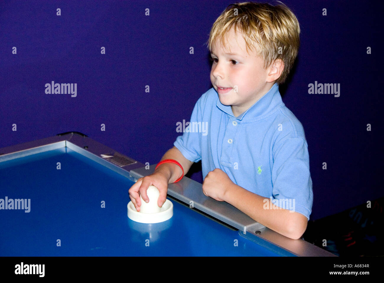 Boy Age 7 Playing Air Hockey At Pump It Up   The Inflatable Party Zone