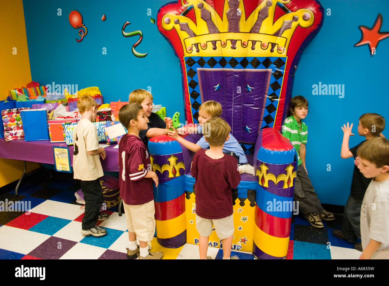 Boys age 7 celebrating birthday at Pump It Up - The Inflatable Party Zone entertainment for children.  Burnsville - Stock Image