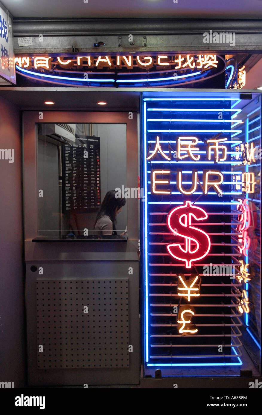 Neon signs in shape of foreign currencies at a currency exchange office in Hong Kong China - Stock Image